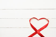 White background with heart shaped ribbon Stock Photography