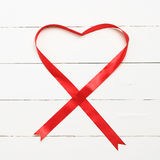 White background with heart shaped ribbon Stock Photos