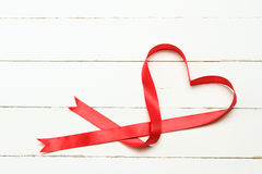 White background with heart shaped ribbon Royalty Free Stock Image