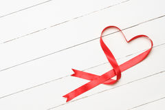 White background with heart shaped ribbon Royalty Free Stock Images