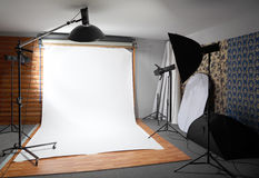 White background inside studio - lighted lamps. White background inside studio - dark room lighted big lamps and spotlights royalty free stock image