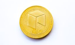 Crypto currency digital gold front coin - neo. On a white background is isolated gold coin of a digital crypto currency - neo with free space for text. The front royalty free stock images
