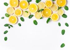 Photo of orange and lemon slices with mint on a white background. Background for the design of banners, websites, blogs, stock image