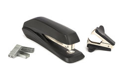 On a white background lie a stapler staples for stapler and anti-stapler Stock Photos