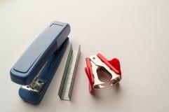 Stapler, anti-stapler on a white background stock photography