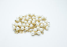 On a white background lies a pearl necklace on the neck and bracelet Royalty Free Stock Photos