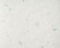 White background, lime plaster wall with scratches and irregularities Royalty Free Stock Photos