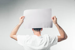 on white background man holds a poster bearded Stock Images