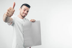 on white background man holds a poster bearded Stock Image