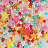 White background with multicolored sprinkles confectionery Stock Images