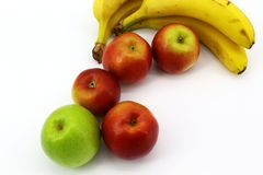 Fresh fruit on white background: bananas and apples stock photos