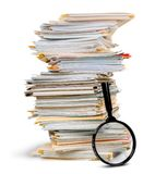 Stack of Documents / Files with Magnifying Glass royalty free stock photo