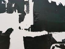 White background with peeling black paint stock photo