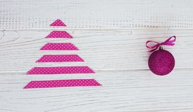 White background with a pink tree. The concept of Christmas and stock image