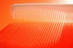 White background with red comb and backlight Stock Photos