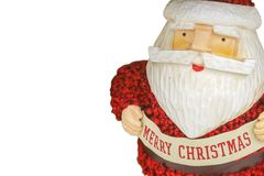 White background of rustic colorful woodcut santa with Merry Christmas banner and fluffy knit suit - Room for copy royalty free stock photo