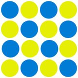 Blue and yellow dots on white. White background with seamless blue and yellow dots Stock Photos