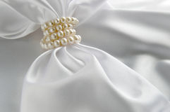 White background with silk and pearl Royalty Free Stock Photography