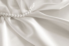 White background with silk and pearl Royalty Free Stock Photo