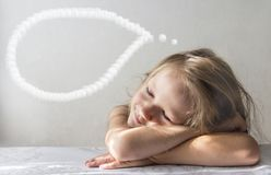 On a white background a sleeping smiling dream girl lies in the rays of the sun morning copy space royalty free stock image