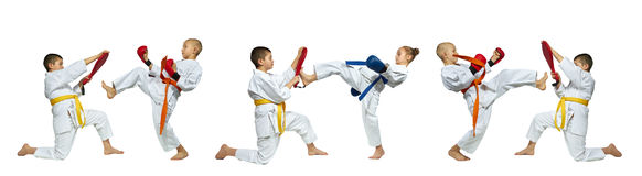 On the white background sportsmen are beating blows leg forward on simulator collage Royalty Free Stock Images