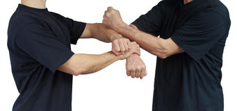 On a white background techniques of Wing Chun are performing two athletes Stock Images