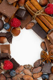 White background for text with assorted chocolate, spices Royalty Free Stock Photos