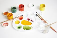 On a white background there is a still life with art supplies stock photography