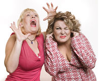 On a white background two adult women blonde scare Stock Photos
