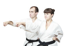 On white background two adults sportsmen are beating punch hand Stock Photo