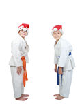 On a white background two athletes in caps of Santa Claus doing bow Stock Photo
