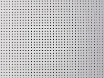 White background of wall with holes. Design, concept. Stock Photos
