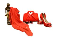 Isolant on a white background-red accessories, sandals with bows. On a white background - women`s red accessories, bag with handles in the form of a heart Stock Photography
