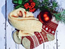 New year and Christmas card. On a white background wood lie knitted socks with Christmas ornaments and lots of Christmas Toys stock image