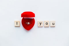 White background with wooden words I LOVE YOU and diamond ring Royalty Free Stock Photos