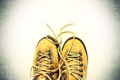White background with yellow shoes royalty free stock photography