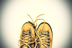 White background with yellow shoes Royalty Free Stock Image