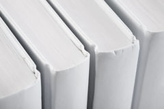 White backs of books close up Royalty Free Stock Photography