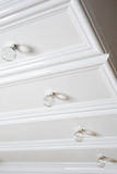 White badroom shelf with rounded handles. Close up of a white MDF bedroom shelf and handles stock image