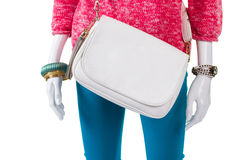 White bag and pink pullover. Plain leather purse on mannequin. Woman's brand new leather handbag. Discount for trendy accessories Stock Photos
