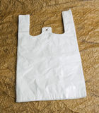 White bags with handle on brown design paper. Royalty Free Stock Images