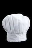 A white baker's toque on a black background Stock Photo