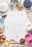 White Baking Cooking Background. Various food ingredients and cooking utensils on a white marble background from overhead Stock Images
