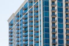 White Balconies on Blue Glass Condominium Royalty Free Stock Photography