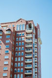 White Balconies on Brown Condo Tower. A White Balconies on Brown Condo Tower under clear blue sky Stock Image