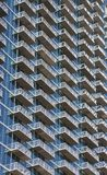 White Balconies Rising on Blue Glass Condo Tower Royalty Free Stock Photos