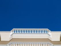 White balcony balustrades. Low angle view of classic white balcony balustrades stock image