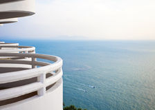 White balcony looking over beautiful blue ocean Stock Photography