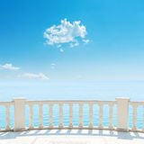 White balcony near sea and blue sky with clouds. White balcony near sea and blue sky with cloud over it Royalty Free Stock Photography