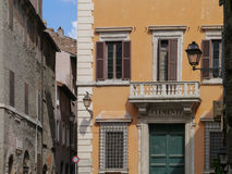 White balcony in old street in Rome, Italy. White balcony on building in Old Street  in downtown and Mediterranean architecture in Rome, Italy Stock Photos